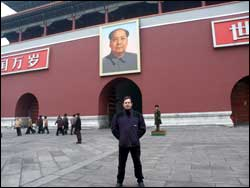 Peter Broadbent under the famous image of Mao Tse Tung (also Mao Zedong)